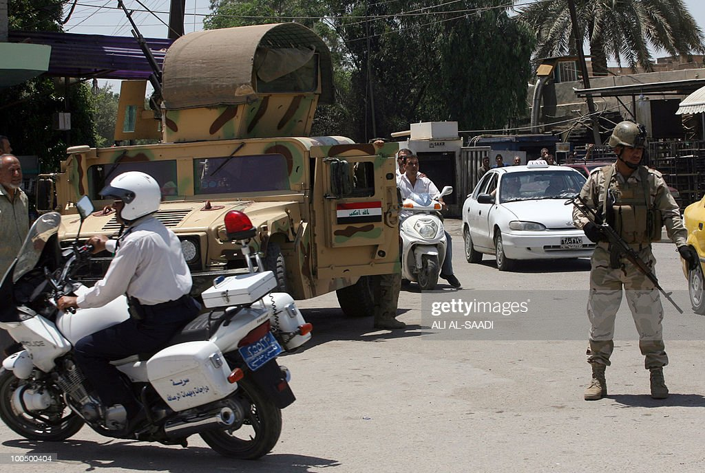 Iraqi soldiers secure an area in Baghdad