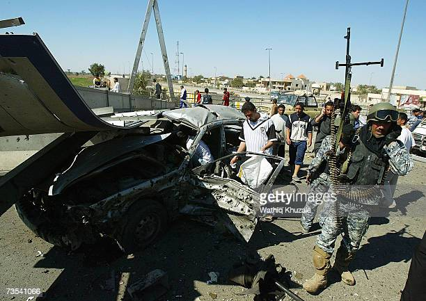 Iraqi soldiers secure the scene of a car bomb explosion on March 10 2007 near Sadr city Shiite neighborhood in Baghdad Iraq As delegates from Iraq...