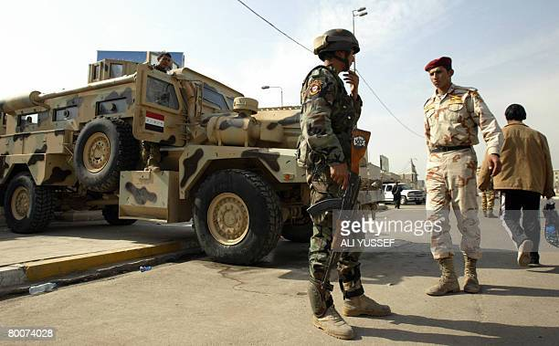 Iraqi soldiers stand guard at a checkpoint in downtown Baghdad on March 1 2008 President Mahmoud Ahmadinejad who is scheduled to visit Iraq tomorrow...