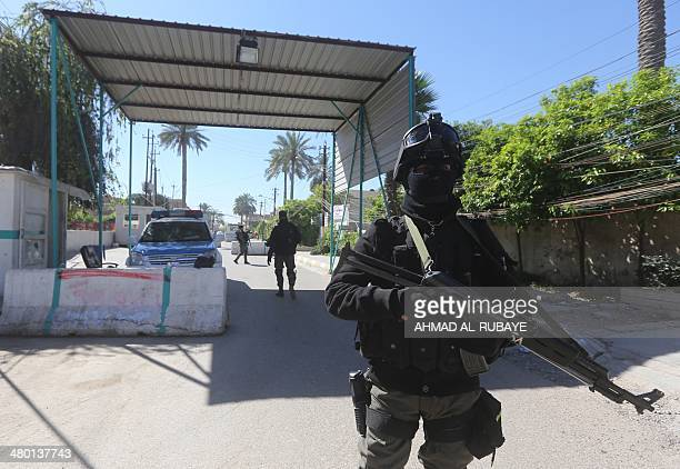 Iraqi soldiers stand guard at a checkpoint outside the presidential compound as they replace Kurdish peshmerga guards on March 23 2014 following the...