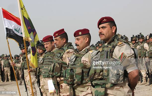 Iraqi soldiers stand guard before going to Mahmur district of Mosul to attend an operation aiming retake the city from ISIS on February 21 at ElTaci...