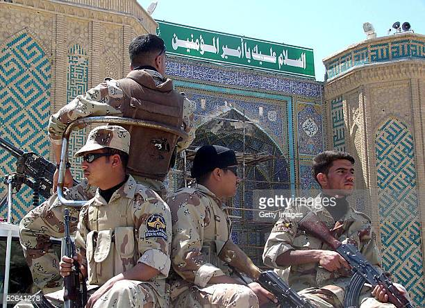 Iraqi soldiers stand guard in front of Imam Ali shrine April 17 2005 in the holy Shiite city of Najaf Iraq Iraqi security forces raided the Iraqi...