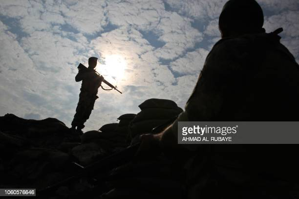 TOPSHOT Iraqi soldiers stand guard near the Iraqi city of Qaim at the IraqiSyrian border on November 11 2018 Iraqi troops reinforced their positions...