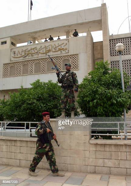 Iraqi soldiers stand guard outside the Nineveh province headquarters as Iraqi Prime Minister Nuri alMaliki spoke inside to local tribal leaders in...