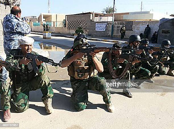 Iraqi soldiers take position in a street of Ramadi west of the capital Baghdad on January 19 2014 during a military operation against antigovernment...