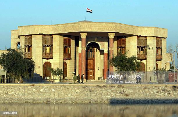 Iraqi soldiers walk outside one of the palaces of Iraq's executed former president Saddam Hussein in the southern city of Basra 08 January 2008 Basra...