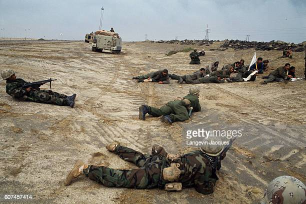 Iraqi soldiers waving a white flag and surrendering to Allied forces that circle them The invasion of Kuwait by Iraqi troops despite warnings from...