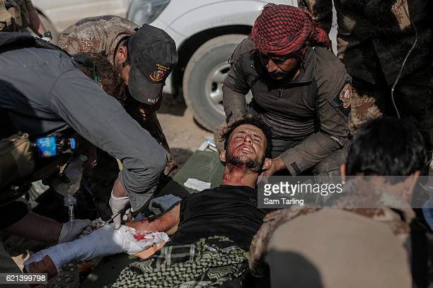 Iraqi Special Forces medics aided by American volunteers help treat a wounded soldier in the Zahara neighbourhood on the north eastern edge of Mosul...