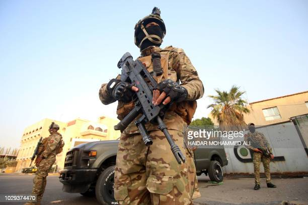 Iraqi special forces members patrol in a street in Basra on September 8 after Iraq's Joint Operations Command, which includes the army and police,...