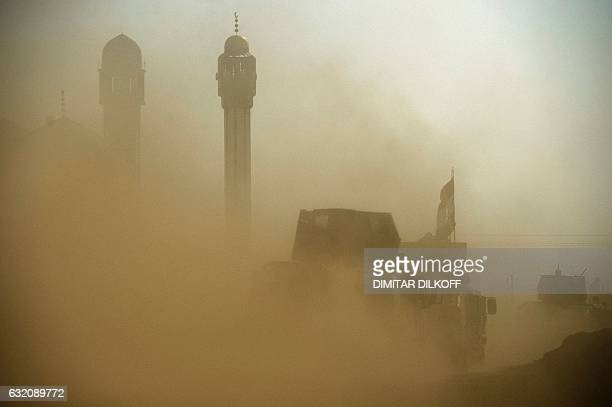 TOPSHOT Iraqi special forces patrol in armored vehicles near the Grand mosque in eastern Mosul on January 19 during the ongoing military operation...