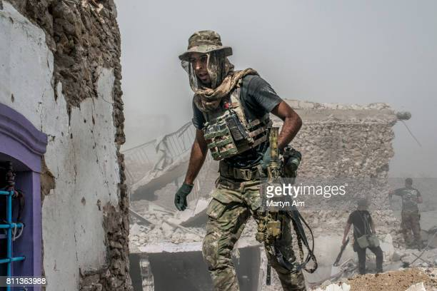 Iraqi Special Operation Forces and Iraqi Army soldiers fight Islamic State militants who occupy the last section of the Old City district on July 9...