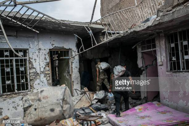 Iraqi Special Operation Forces soldiers carry supplies to a frontline position in the Islamic State occupied Old City district where heavy fighting...