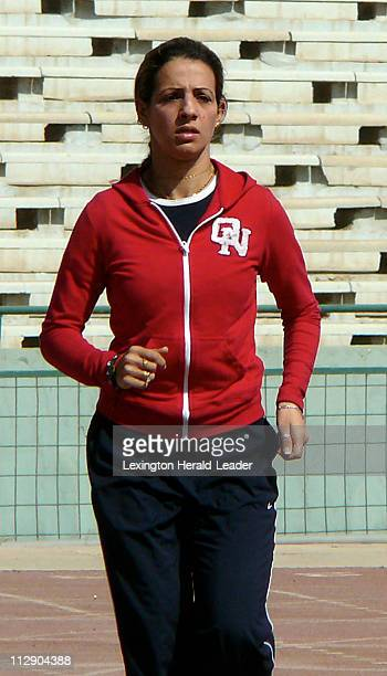 Iraqi sprinter and Olympic hopeful Dana Hussein jogs around the track at a stadium in Baghdad Iraq Hussein is a sprinter and an Iraqi athlete with...