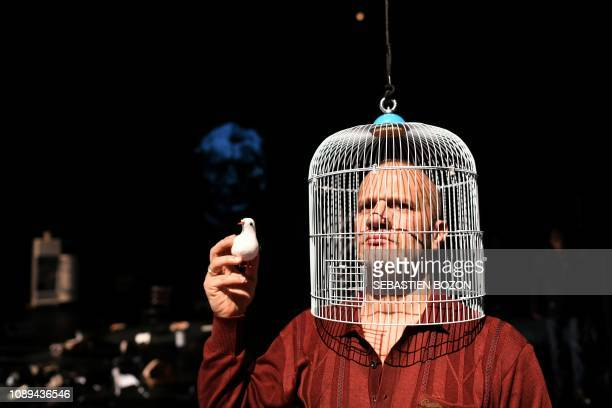 Iraqi stage director playwright and actor Anas Abdul Samad poses on the stage of the Centre Dramatique National in Besancon eastern France on January...
