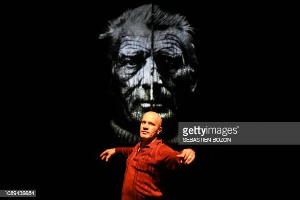 Iraqi stage director playwright and actor Anas Abdul Samad poses on the stage in front of a protrait of Irish writer poet and playwright Samuel...