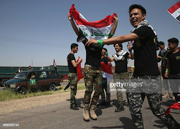 Iraqi student supporters of the Badr Brigade militia stop to celebrate govenrment force advances on April 9 2015 near Tikrit Iraq Government troops...