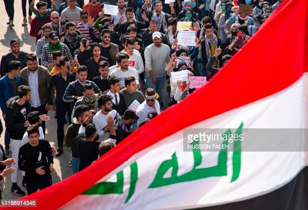 Iraqi students take part in an antigovernment protest in the southern city of Basra on February 6 after a night of violence blamed on supporters of a...