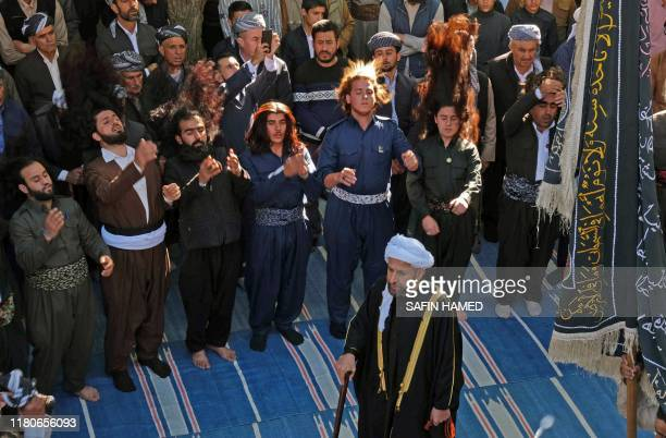 Iraqi Sufi Muslim Kurds take part in a ritual ceremony to celebrate the birth of the Prophet Mohammed in the Kurdish town of Akra 500 kms north of...
