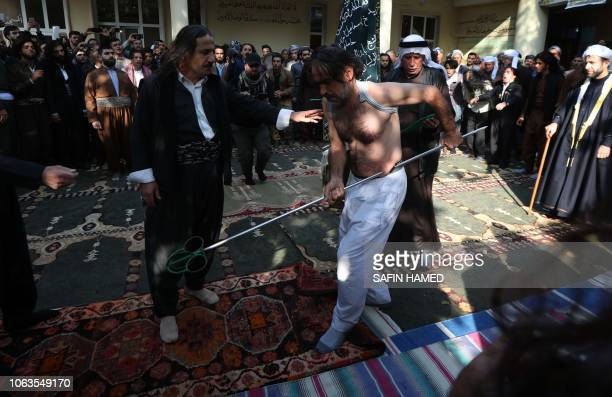 Iraqi Sufi Muslim Kurds take part in a ritual ceremony to commemorate the birth of the Prophet Mohammed in the Kurdish town of Akra 500 km north of...