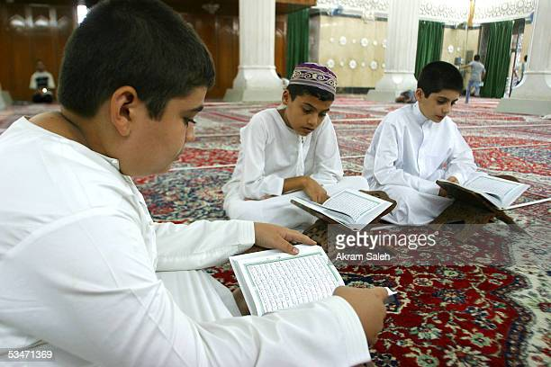 Iraqi Sunni boys read the holy Quran on August 27 2005 at a Sunni mosque in Baghdad Iraq The speaker of Iraq's Transitional National Assembly Hajim...