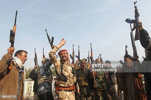 Iraqi Sunni fighters from the Jubur tribe celebrate after defeating Islamic State group in the village of Sharween in Diyala province northeast of...