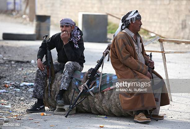 Iraqi Sunni fighters from the Jubur tribe rest after defeating Islamic State group in the village of Sharween in Diyala province northeast of Baghdad...