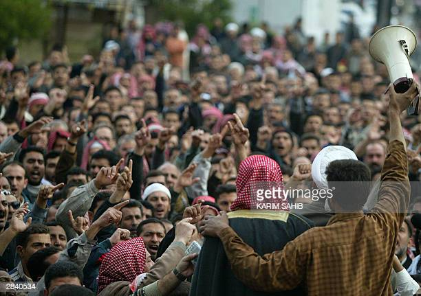 Iraqi Sunni Muslim fundamentalists call for holy war against the Americans during the Friday noon prayer at the Ibn Taimiya mosque in the Yarmuk...