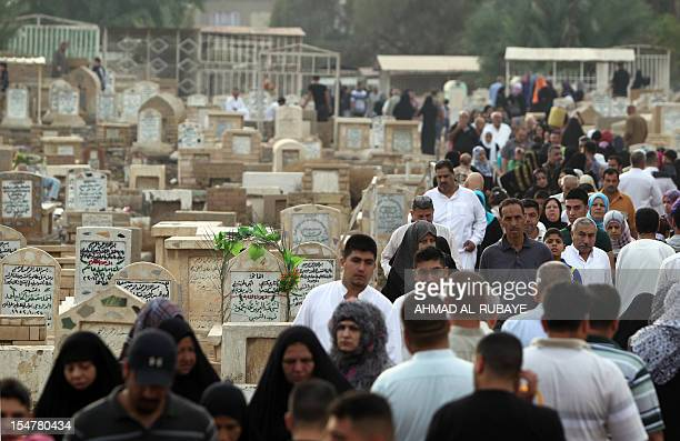 Iraqi Sunni Muslims visit the alGhazali cemetery in Baghdad on the first day of Eid alAdha on October 26 2012 Eid alAdha or 'Feast of sacrifice' is...