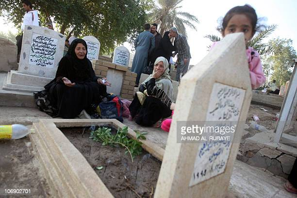 Iraqi Sunni Muslims visit the graves of loved ones at the AlGhazali cemetery in Baghdad on November 16 2010 on the first day of Eid alAdha or the...