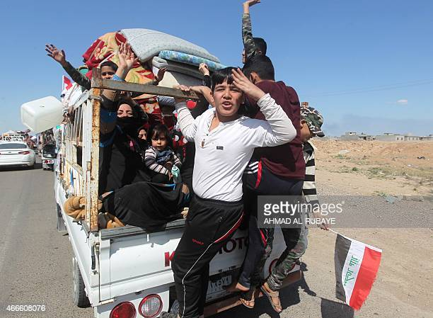 Iraqi Sunni refugees return back to the AlAlam town northeast of the Iraqi city of Tikrit on March 17 2015 after the town was recaptured by Sunni and...