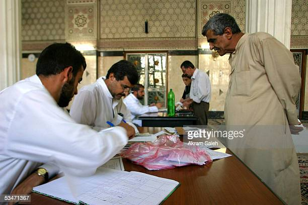 Iraqi Sunnis register their names to vote on the 15th of October referendum on Iraqs new constitution August 27 2005 at a Sunni mosque in Baghdad...
