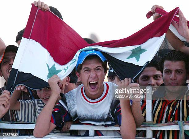 Iraqi supporters celebrate the victory of their country's football team against Saudi Arabia for the final of the Asian Football Cup 2007 29 July...