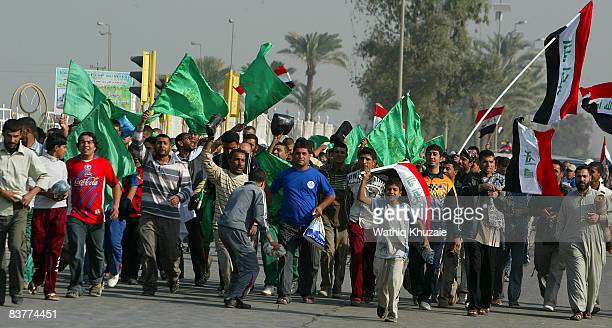 Iraqi supporters of radical Shiite cleric Moqtada al-Sadr chant slogans during a protest on November 21, 2008 in Baghdad, Iraq. Thousands of...