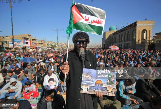Iraqi supporters of Shiite cleric Moqtada alSadr demonstrate after the Friday noon prayers in Baghdad on December 8 2017 to denounce the widely...