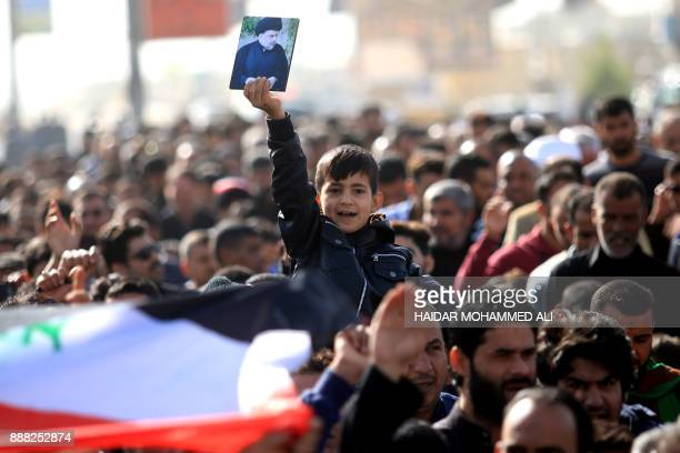 Iraqi supporters of Shiite cleric Moqtada alSadr protest in the southern city of Basra after the Friday noon prayers on December 8 2017 to denounce...