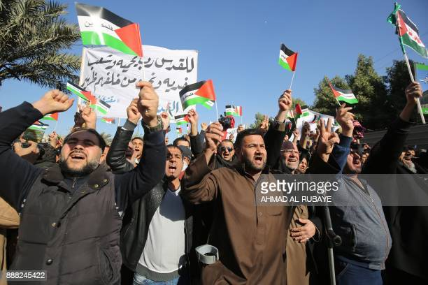 Iraqi supporters of Shiite cleric Moqtada alSadr protest in the streets of Baghdad after the Friday noon prayer on December 8 2017 against the widely...