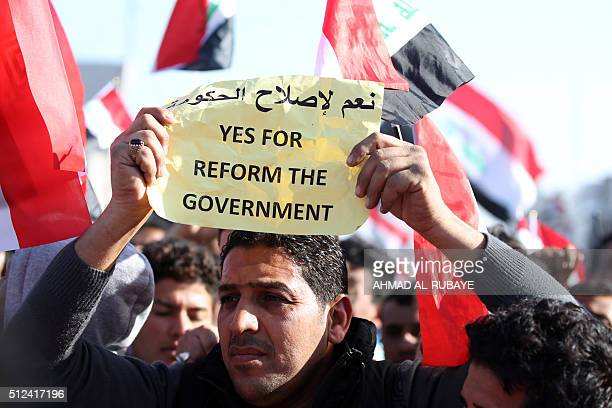 Iraqi supporters of Shiite cleric Moqtada alSadr wave the national flag as they listen to his speech during a demonstration in Baghdad's Tahrir...