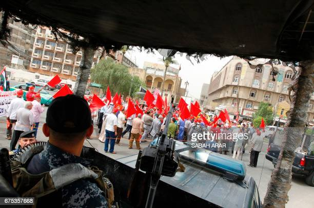 Iraqi supporters of the Communist Party take part in a rally to mark International Workers' Day in Baghdad on May 1 2017 / AFP PHOTO / SABAH ARAR
