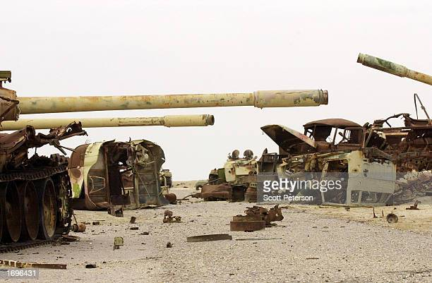 Iraqi tanks destroyed during the 1991 Gulf War sit in a graveyard just north of Iraq's border with Kuwait and Saudi Arabia December 16, 2002 In...