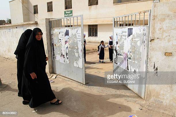 Iraqi teachers arrive to a school in the southern Iraqi city of Basra on April 6 2008 Fierce clashes between Shiite gunmen and US forces in the Iraqi...