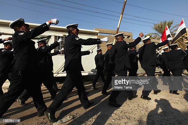Iraqi traffic police practice marching in preparation for ceremonies marking the departure of American troops on December 8 2011 in Baghdad Iraq Iraq...