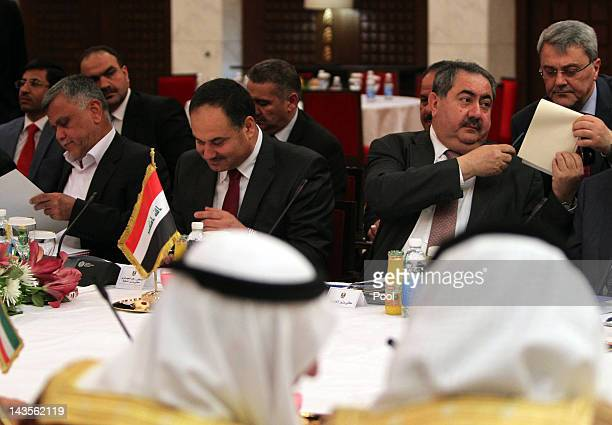 Iraqi Transportation Minister Hadi alAmiri Finance Minister Rafie alIssawi and Foreign Minister Hoshyar Zebari attend the joint IraqiKuwaiti...