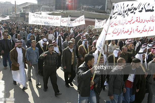 Iraqi tribal leaders representatives of the Nineveh province of northern Iraqi march along the street in the province capital Mosul on November 22...