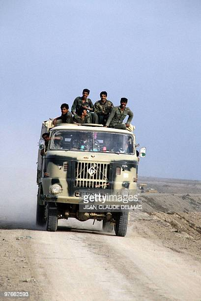 Iraqi troops drive to the front line on March 20 1985 after the battle for the city of alHoweizah north of Basra The IraqIran war began in September...