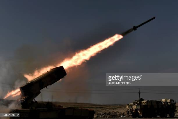 TOPSHOT Iraqi troops fire a missile towards Islamic State group fighters from the outskirts of Mosul as Iraqi forces battle against the group to...