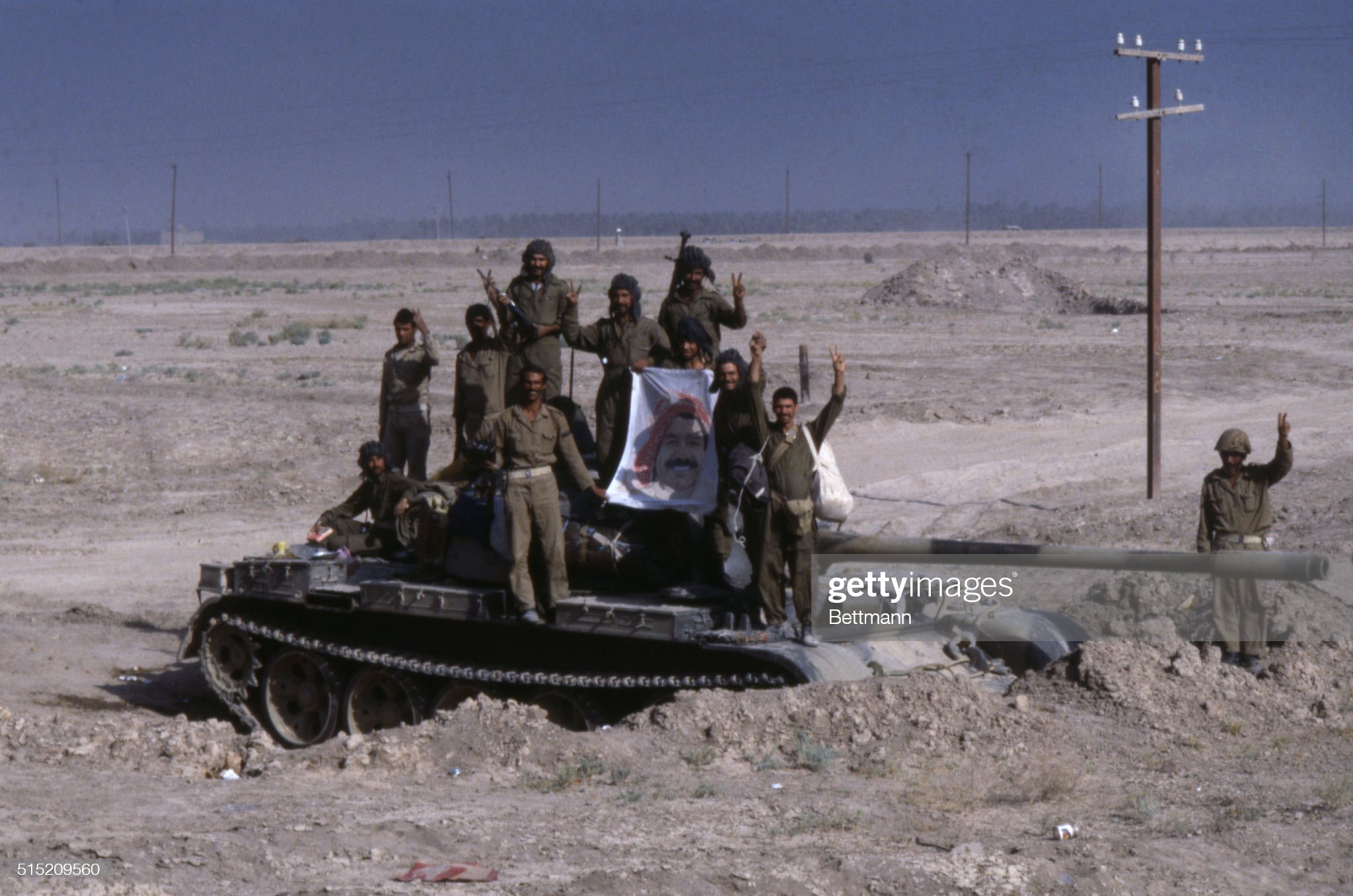 https://media.gettyimages.com/photos/iraqi-troops-give-the-v-for-victory-as-they-stand-atop-their-tank-927-picture-id515209560?s=2048x2048