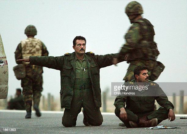 Iraqi troops surrender themselves to US Marines March 21 2003 in Safwan Iraq Chaos reigned in southern Iraq March 21 as coalition troops continued...