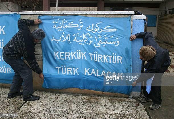 "Iraqi Turkmen put up a banner that reads, ""Kirkuk is Turkmen, and will remain Turkmen forever"", in the city of Kirkuk, northern Iraq 18 January 2005...."