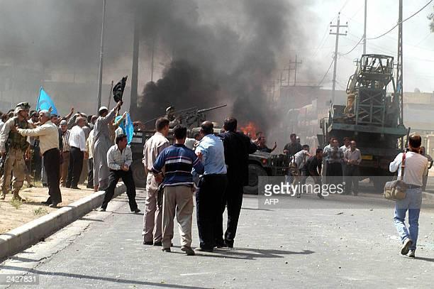 Iraqi Turkmen stage a demonstration 23 August 2003 in Kirkuk to protest the 22 August killing of seven Iraqi Turkmen by Peshmergas. Three Turkmen...