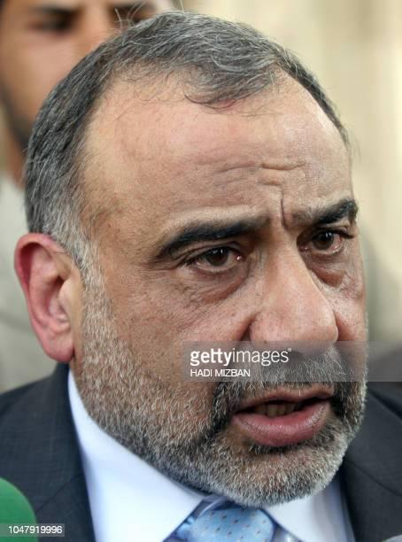 Iraqi Vice President Adel Abdel Mehdi talks to reporters following his meeting with Jordan's Prime Minister Adnan Badran in Baghdad 10 September 2005...